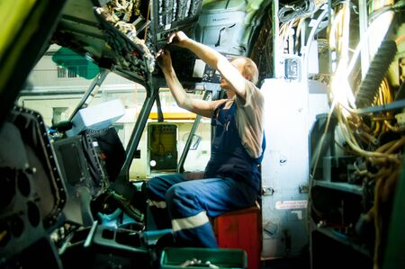 Tyumen, Russia - June 5, 2019: Aircraft repair helicopter UTair Engineering plant. Engineer maintaining a Mi-8 helicopter control Editorial