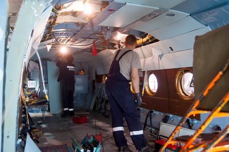 Tyumen, Russia - June 5, 2019: Aircraft repair helicopter UTair Engineering plant. Worker maintaining a Mi-8 helicopter