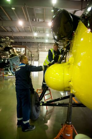 Tyumen, Russia - June 19, 2019: Aircraft repair helicopter UTair Engineering plant. Workers maintaining a Mi-8 helicopter Editorial