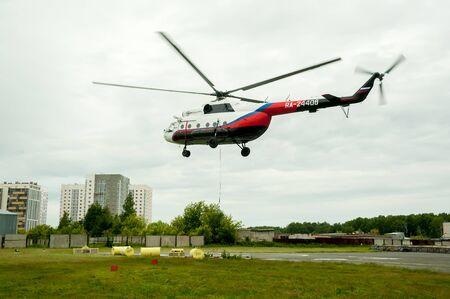 Tyumen, Russia - June 19, 2019: Aircraft repair helicopter UTair Engineering plant. Test flight of MI-8 helicopter aftr repairing Redakční