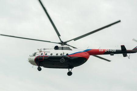 Tyumen, Russia - June 19, 2019: Aircraft repair helicopter UTair Engineering plant. Test flight of MI-8 helicopter after repairing Redakční