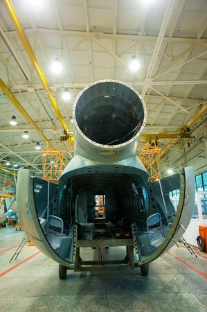 Tyumen, Russia - June 5, 2019: Aircraft repair helicopter UTair Engineering plant. Mi-8 helicopter during maintencance and repair at the service hangar
