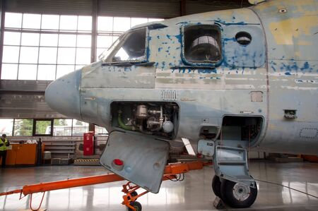 Tyumen, Russia - June 19, 2019: Aircraft repair helicopter UTair Engineering plant. Mi-26 helicopter during maintencance and repair at the service hangar