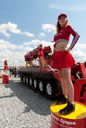Tyumen, Russia - August 4, 2017: International Army Games. Full length portrait of a racing girl standing on barrel Editorial