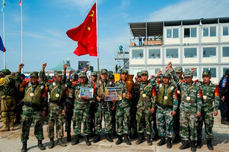 Tyumen, Russia - August 10, 2019: Army Games. Engineering Formula contest. Highest military and engineering school ground. Awards ceremony of winners. Team of China