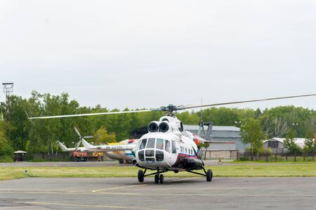 Tyumen, Russia - June 19, 2019: Aircraft repair helicopter UTair Engineering plant. Test flight of MI-8 helicopter after repairing Editöryel