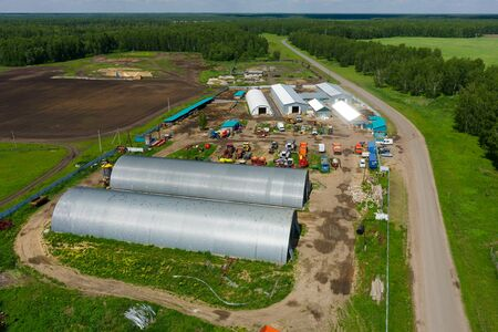 Aerial view onto modern machine yard of agricultural firm. Sverdlovsk region