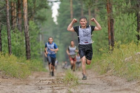 Tyumen, Russia - July 1, 2017: Race of Heroes project on the ground of the highest military and engineering school. . Athletes run between stages