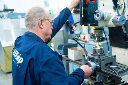 Tyumen, Russia - June 5, 2019: Aircraft repair helicopter UTair Engineering plant. Milling-machine operator works at the machine Foto de archivo - 139048507