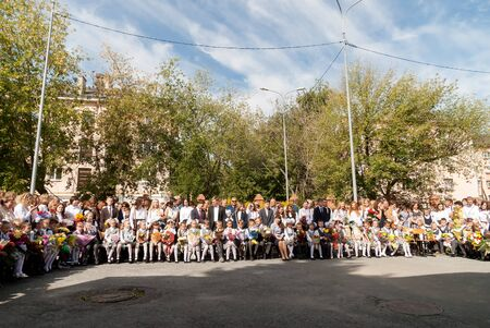 Tyumen, Russia - September 1, 2017: Gymnasium number 5. Primary school children with actor on the first day of the school year. Feast Day of Knowledge.