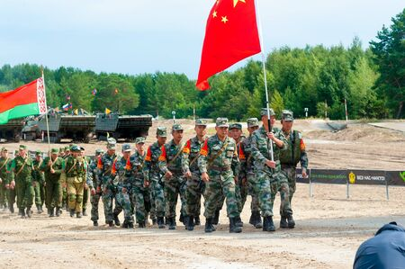 Tyumen, Russia - August 10, 2019: Army Games. Engineering Formula contest. Highest military and engineering school ground. Chinese and belarus teams go to award ceremony Editorial