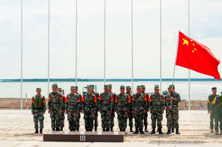 Tyumen, Russia - August 10, 2019: Army Games. Engineering Formula contest. Highest military and engineering school ground. Team of China on awards ceremony of winners