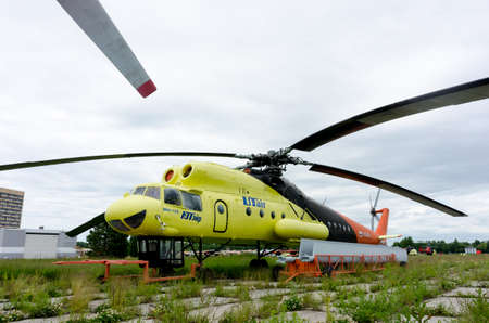 Tyumen, Russia - June 19, 2019: Aircraft repair helicopter UTair Engineering plant. Old MI-10K helicopter 에디토리얼