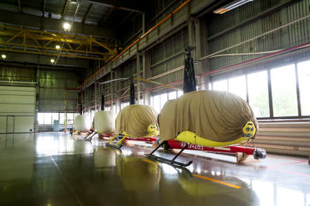 Tyumen, Russia - June 19, 2019: Aircraft repair helicopter UTair Engineering plant. Robinson R44 helicopters after maintencance and repair in service hangar Editoriali
