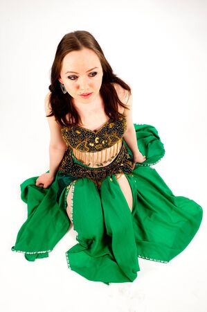Beautiful girl in belly dance costume on a white background