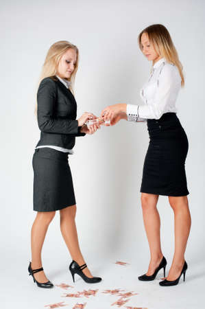Two young business ladies argue because of paper money Stock fotó