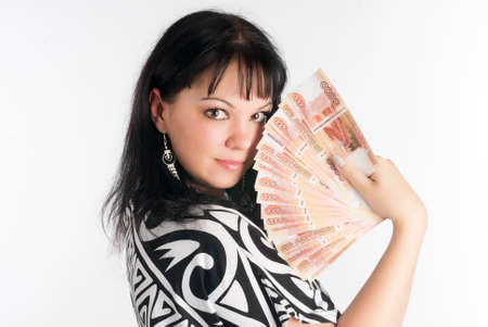 Young attractive woman with currency over white background