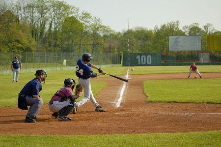 baseball catcher: Player hitting ball Stock Photo