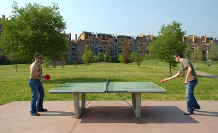 pong: boys playing ping pong Stock Photo