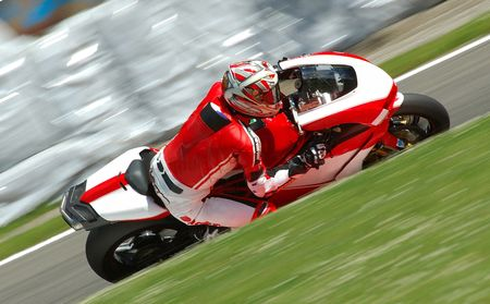 visible: A motorbike racing in circuit, visible panning