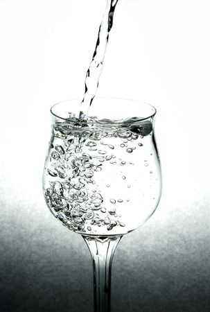 healty: Pouring water in a cristal glass