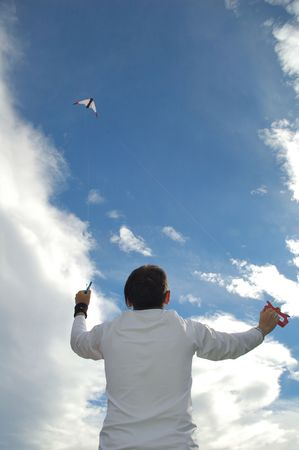 A boy playing with kite photo