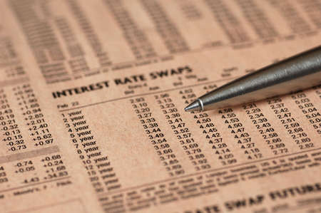 interest rates: Interest rates over a financial newspaper - shallow dof Stock Photo