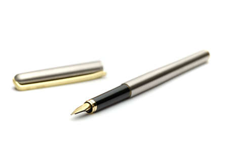 Golden fountain pen and cap isolated on white - shallow dof photo