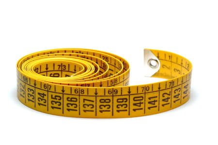 Yellow meter tape isolated over white background photo