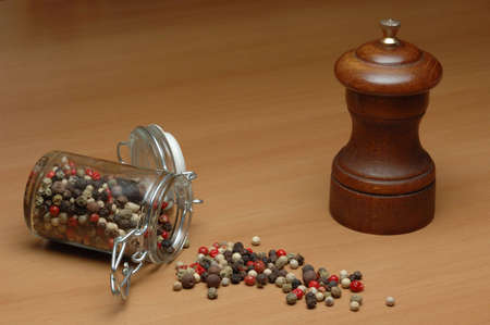 Coloured pepper and pepper grinder photo