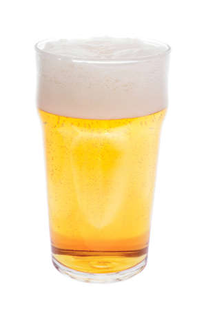 A glass of beer with foam isolated on white background photo