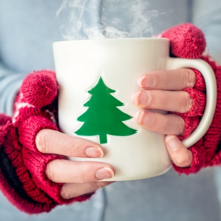 christmas drink: Woman holding tea cup Stock Photo