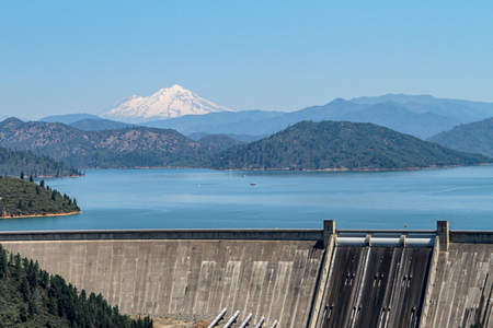 Vista of Shasta Lake and dam with Mount Shasta in the background