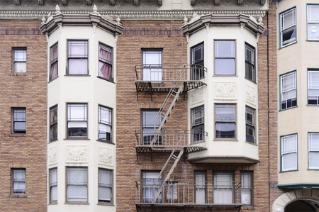 many windows: Modern red brick wall with many windows, San Francisco