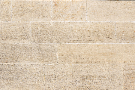 beige: Beige stone wall background texture close up Stock Photo