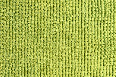 purl: Green wool texture background close up