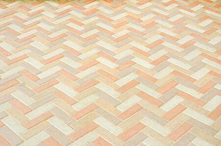 Road mosaic pavement texture background close up