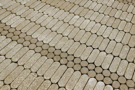 Beige granite mosaic pavement background texture close up