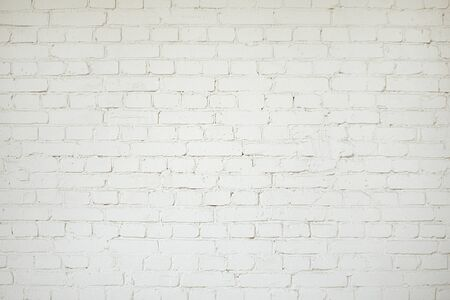 Old white brick wall background texture close up Imagens