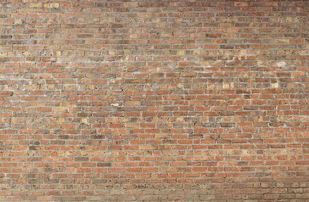 Vecchia fine rossa di struttura del fondo del muro di mattoni su