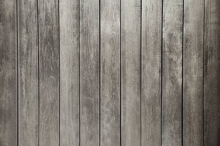 Old dark grey wooden wall background texture close up