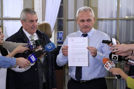 Bucharest, Romania - December 28, 2016: Calin Popescu Tariceanu (L), leader of Liberal Democrat Alliance (ALDE) and Social Democrat leader, Liviu Dragnea (R), shows a letter addressed to the Romanian