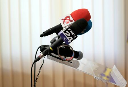 Bucharest, Romania - September 09, 2018: A microphone of the Romanian television Digi 24 and one from Realitatea TV are seen before a press release. This image is for editorial use only.