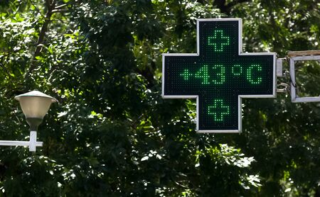 Bucharest, Romania - July 02, 2019: 43 degrees celsius (109.4 fahrenheit) is the temperature displayed by a digital thermometer on a hot summer outside a pharmacy. This image is for editorial use only.