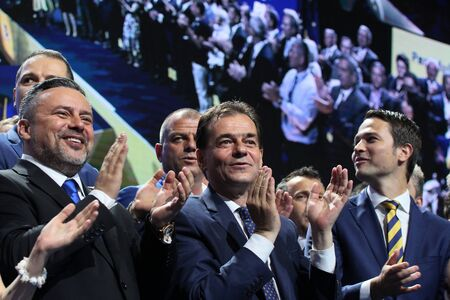 Bucharest, Romania - June 17, 2018: Ludovic Orban (C) enjoys together with Ioan Balan (L) and Robert Sighiartau (R) after was elected president of the National Liberal Party, in Bucharest.