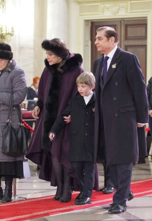 Bucharest, Romania - December 13, 2017: Paul Lambrino (D), also known as Prince Paul of Romania, with his son Carol Ferdinand (C) and wife Lia (S) wait to pay their respects in front of the coffin with the remnants of King Michael I of Romania is in the R