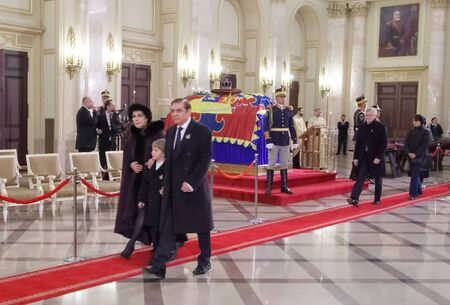 Bucharest, Romania - December 13, 2017: Paul Lambrino (D), also known as Prince Paul of Romania, with his son Carol Ferdinand (C) and wife Lia (S) leave after paying their respects in front of the coffin with the remnants of King Michael I of Romania is i