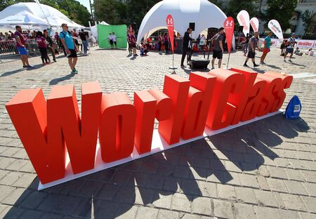 Bucharest, Romania - May 13, 2018: The World Class fitness company's ad is present at its stand during a sport event, in Bucharest, Romania. Redactioneel