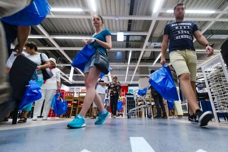 Bucharest, Romania - June 24, 2019: Buyers and curious visitors to see how the new IKEA Pallady store looks are seen in the opening day of the second IKEA store in Bucharest and elsewhere in Romania.