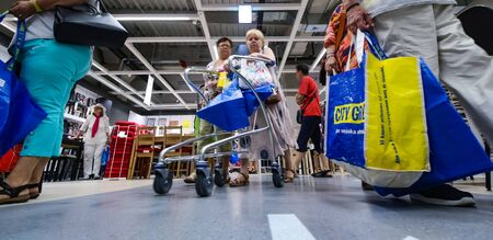 Bucharest, Romania - June 24, 2019: Buyers and curious visitors to see how the new IKEA Pallady store looks are seen in the opening day of the second IKEA store in Bucharest and elsewhere in Romania. Redactioneel